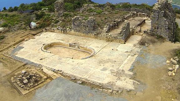 An aerial photograph of the archaeological excavation of Antiochia ad Cragum in Turkey that shows one of the mosaics uncovered at the site.