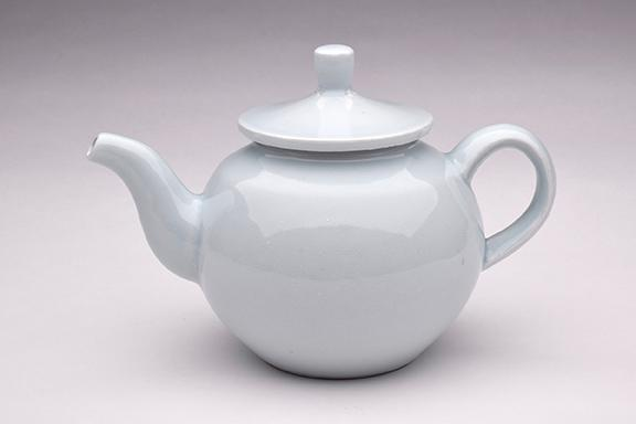 "Pete Pinnell, ""Teapot,"" porcelain with celadon glaze, 7"" x 10"" x 6"", 2017."