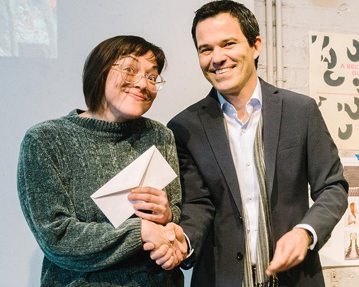 Rosana Ybarra receives the first Nebraska Innovation Studio Residency Award from School of Art, Art History & Design Director Francisco Souto.