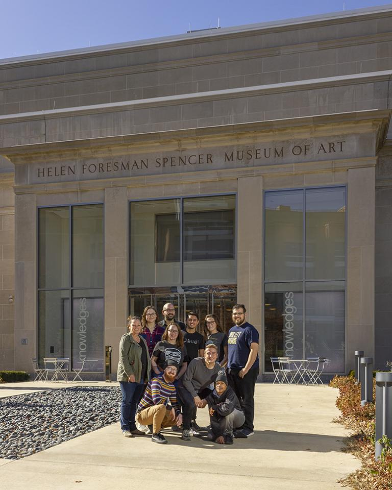 Assistant Professors Colleen Syron (back row, left) and Walker Pickering (back row, third from left) and eight students at the Spencer Museum of Art during the a2ru national conference. Courtesy photo.