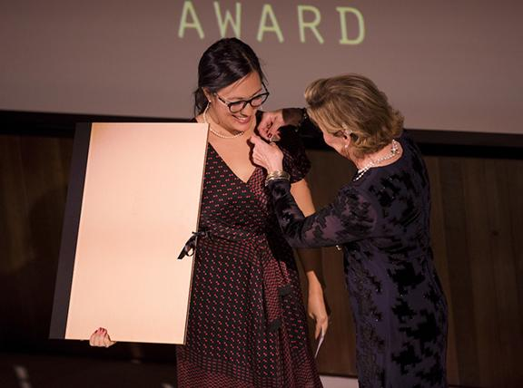 Her Majesty Queen Sonja of Norway (right) presents the Queen Sonja Print Award 2018 to Emma Nishimura on Nov. 8. Photo: Nina Rangøy / NTB scanpix.