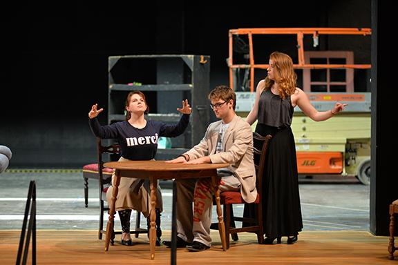 """(left to right) Amy Almond, Hunter Mruz and Abbie Austin rehearse a scene from Noel Coward's """"Blithe Spirit"""" on Feb. 11. Photo by Michael Reinmiller."""