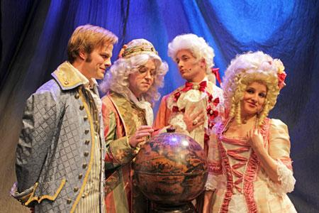 """Candide (Adam Fieldson), Dr. Pangloss (Sam Hartley), Maximilian (Nolan Henkle) and Cunegonde (Kendall Reimer) — students gathered around the globe with their teacher."
