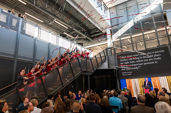 Carson Center students launch confetti from the stairs of the new facility during the Nov. 17 grand opening celebration. Photo by Justin Mohling.