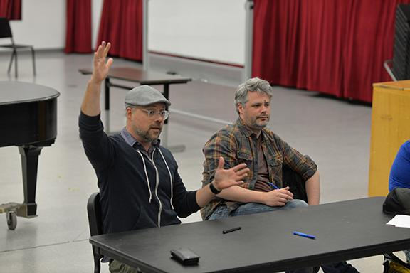Nathan Tysen (left) and Chris Miller meet with students in the Glenn Korff School of Music. Photo by Michael Reinmiller.