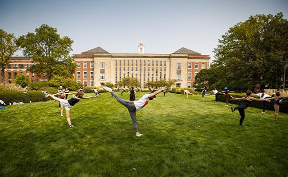 Students in a modern dance class led by Susan Ourada practice on the green space south of Love Library on Sept. 17. Support from donors has helped remove the university's dance program from a list of proposed budget reductions. Photo by Craig Chandler, University Communication.