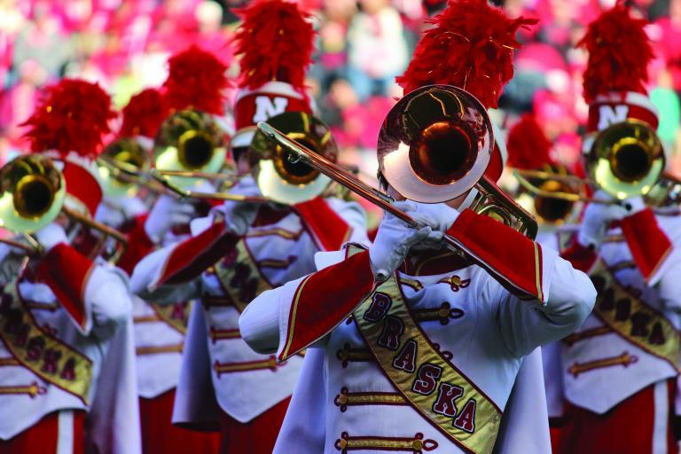 The Cornhusker Marching Band performing at Memorial Stadium