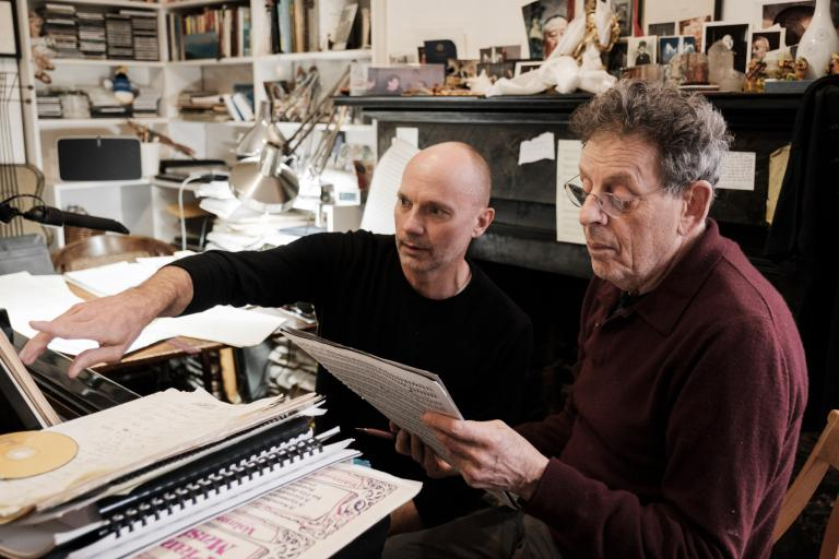 """Paul Barnes (left) and Philip Glass review the score for """"Annunciation."""" Photo by Peter Barnes."""