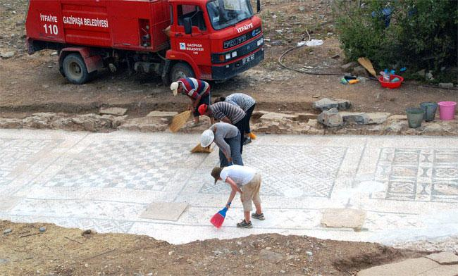 The Roman mosaic uncovered by Hixson-Lied Professor of Art History Michael Hoff's team measures approximately 25x7 meters and served as the forecourt for the adjacent large bath.