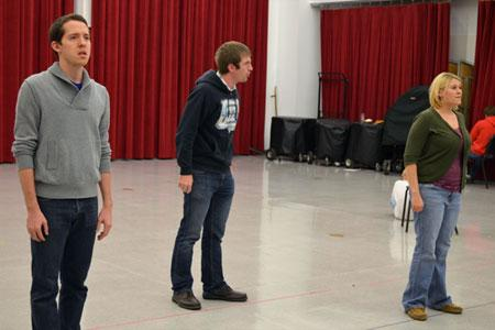 "(L-R) Timothy Patrick Madden, Matthew Clegg and Talea Bloch rehearse a scene from the opera ""O Pioneers!"""