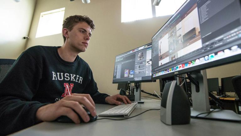 Ben working in a Film & New Media lab.