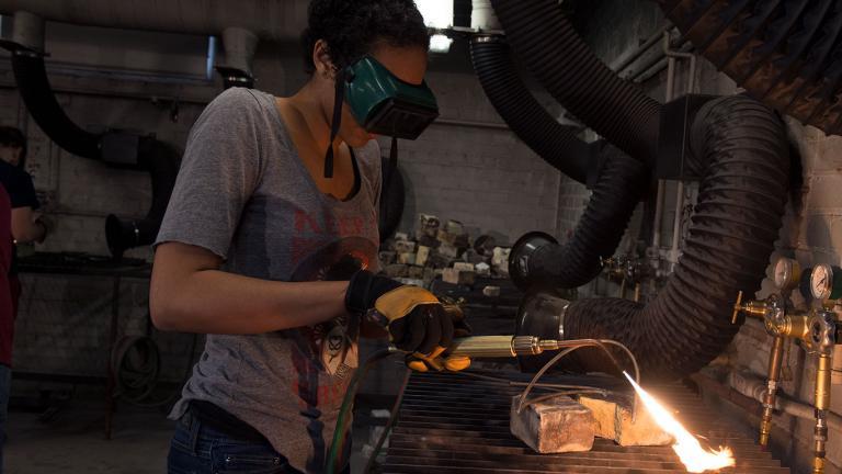 Jamaica welding in the sculpture studio