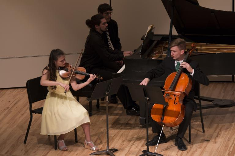 Trio playing on stage