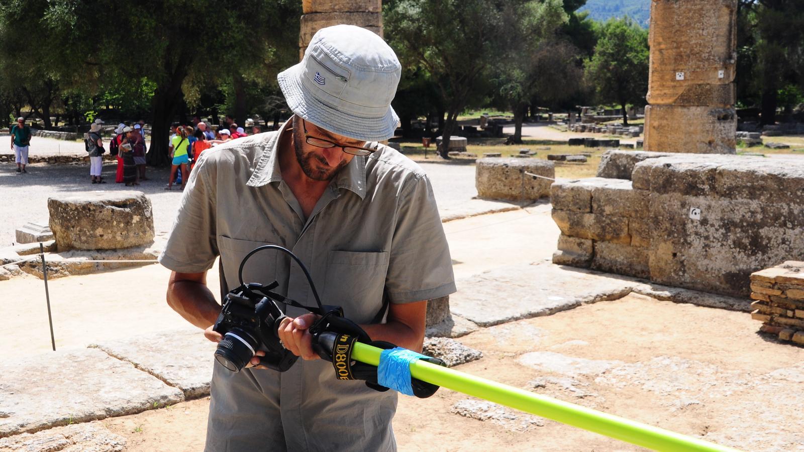 Philip Sapirstein holding a camera