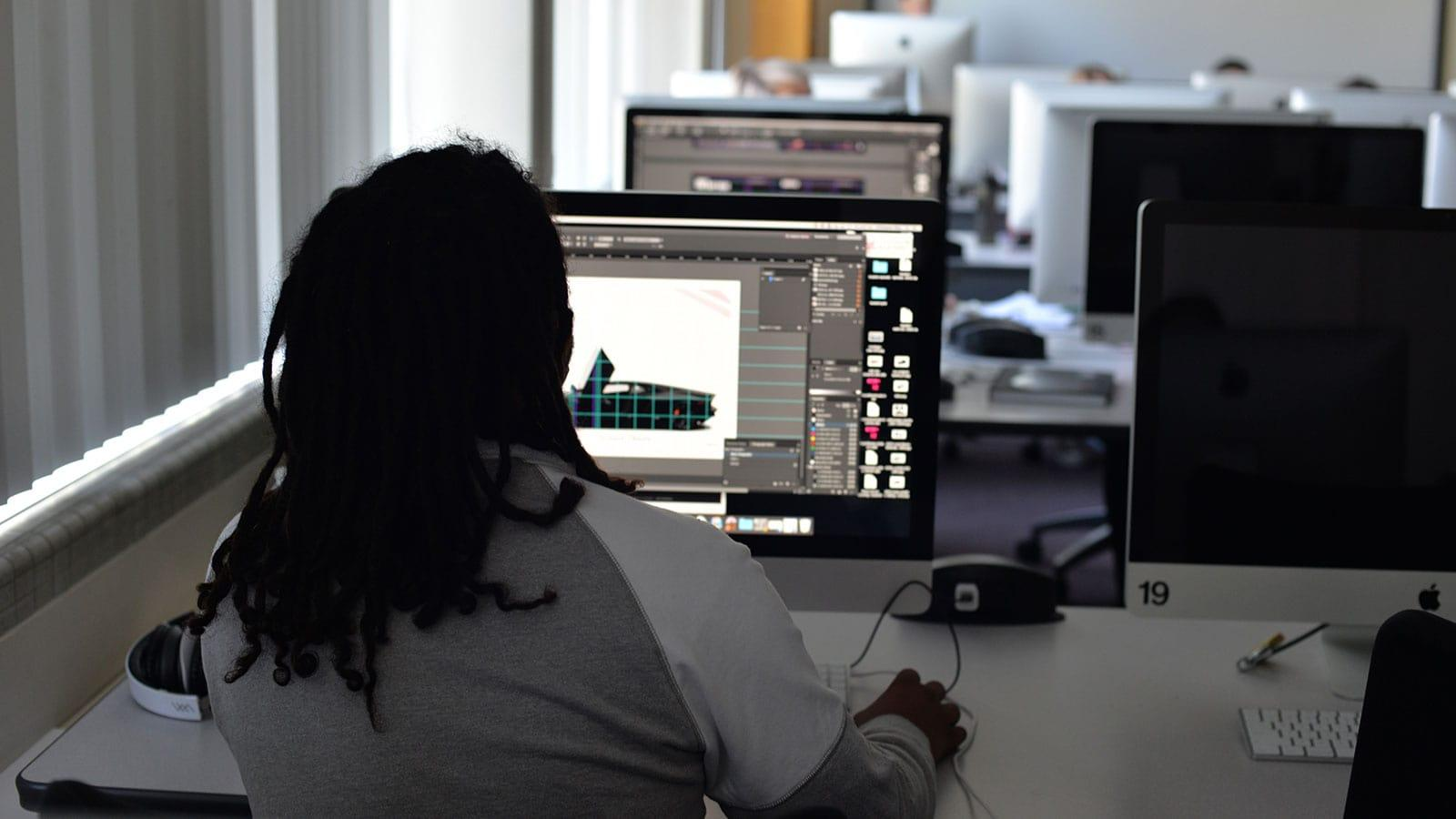 graphic design student working in a lab on a design project