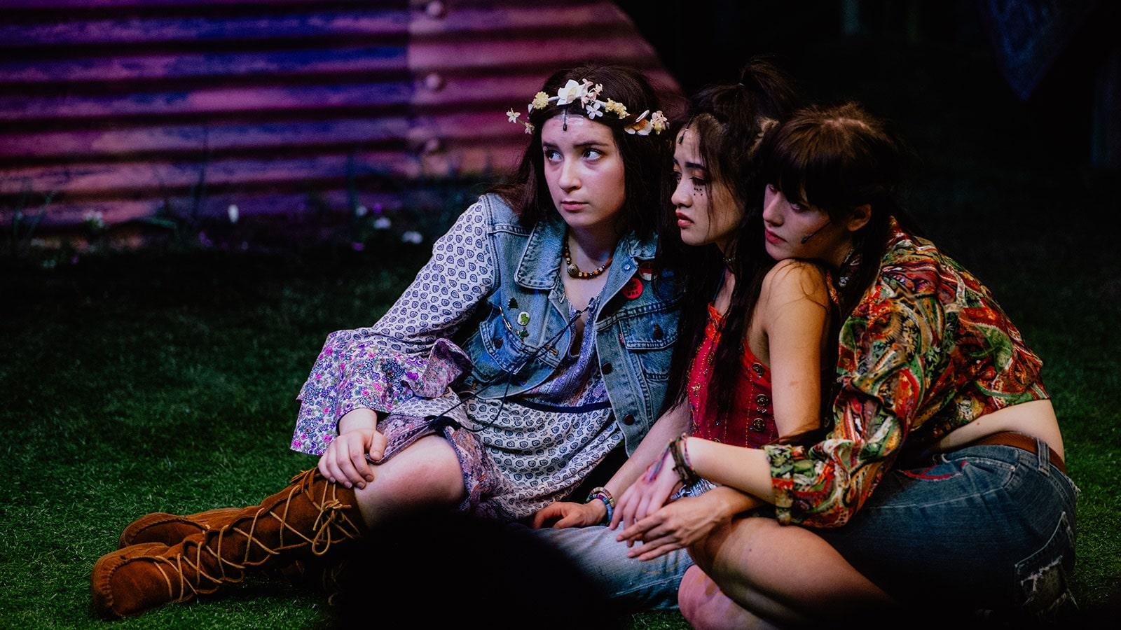 three theatre students performing Hair